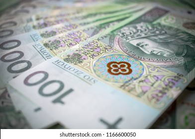 Currency 100 PLN bills issued by National Bank of Poland arranged in photograph - Shutterstock ID 1166600050