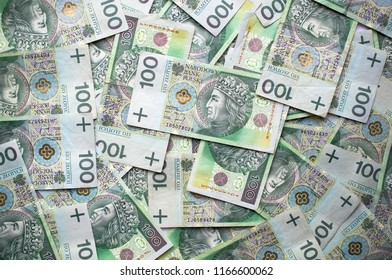 Currency 100 PLN bills issued by National Bank of Poland arranged in photograph - Shutterstock ID 1166600062