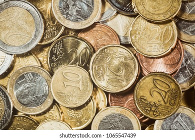 Currency background - a large pile of Euro coins. Top view.
