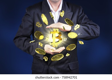 Currency bitcoin gold symbols in a man hand