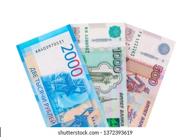 Currency in cash rubles, banknotes nominal 500, 1000, 2000, isolated on white background.
