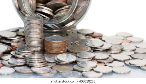 Currency coin stack on how to save money concept.