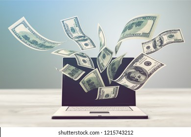 Currency computer electronic banking internet laptop making money wealth
