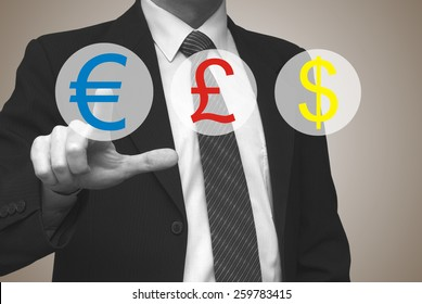 Currency concept, businessman pressing euro button on virtual screen
