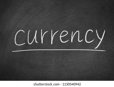currency concept word on a blackboard background