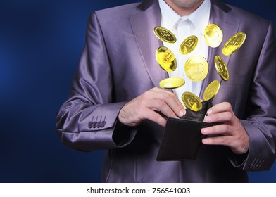 Currency dogecoin gold symbols in a man hand