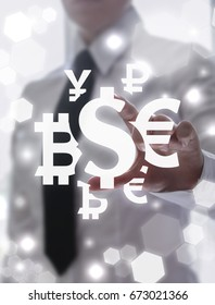 Currency Exchange Financial Business Technology. Man touched dollar ruble yen euro bitcoin currencies icons on virtual screen.