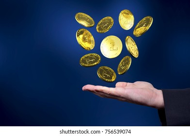 Currency litecoin gold symbols in a man hand