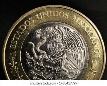 Currency: A macro shot of a 10 pesos mexican coin. Moneda de 10 pesos mexicanos.