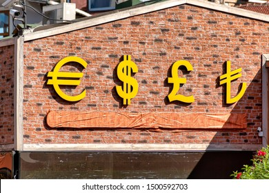 Currency symbols displayed on a brick wall. USD, EUR, GBP and TRY currency signs for Dolar, Euro, Pound and Turkish Lira.