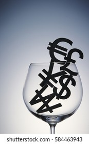 Currency symbols in wine glass