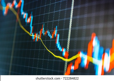 Currency trading theme. Stock diagram on the screen. Forex market charts on computer display. Stock market quotes on display. Stock trade live. Stock analyzing.