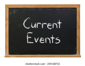 Current events written in white chalk on a black chalkboard isolated on white