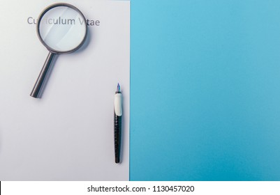 Curriculum vitae written on an blank white paper on blue background