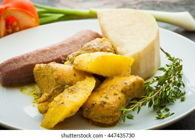 Curried Chicken with cooked potatoes and served with yam and boiled green bananas.