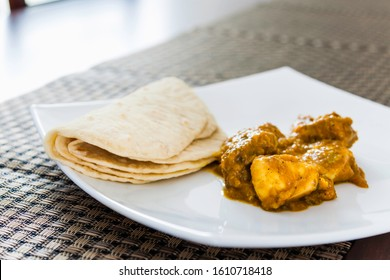 Curried Chicken with Roti Parata or Roti, popular Middle Eastern/Indian cuisine
