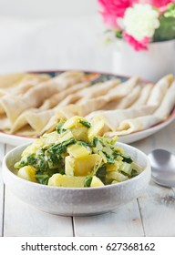 Curried potatoes with swiss chards