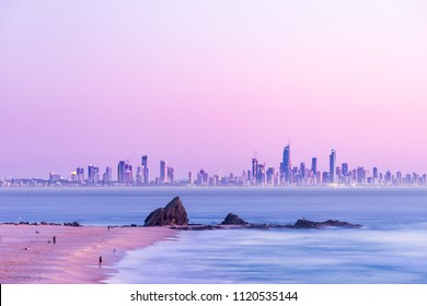 Currumbin Rock with the Gold Coast skyline at sunrise with a pink sky