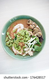 Curry chicken noodles (KHANOM CHIN) with vegetable.