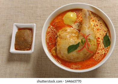 Curry Chicken served in bowl with curry paste