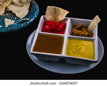 Curry Condiments Served With Broken Poppadoms