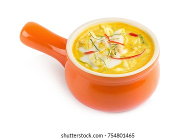 Curry crab, Seafood with Yellow curry sauce in orange ceramic pot, Isolated on white background.