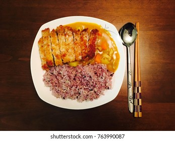 Curry Pork Katsu with Rice on the wooden dining table