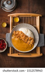 Curry rice japan with hot tea . //Tonkatsu, Japanese pork cutlet, Japanese deep-fried pork curry rice, Japanese curry, Katsu curry . top view