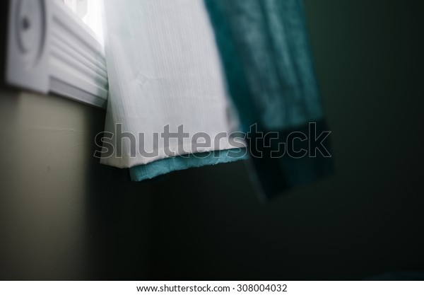 Curtain blowing in wind