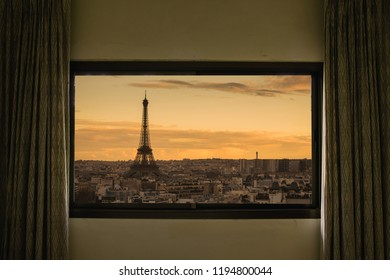 Curtain interior decoration in living room, Eiffel as seen through window.