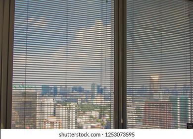 curtain, Louvers , shade, blind or shutters background on tall building that Select focus point.