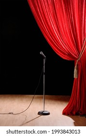 Curtain and Microphone on Stage. Mic in front of Red curtain on an empty stage after the concert.