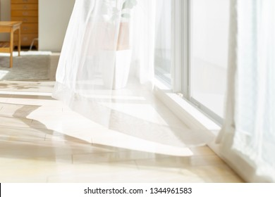 Curtain swaying in the wind