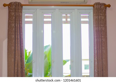 curtain with white glass window.