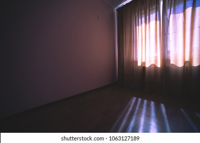 curtained window in room