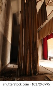 Curtains backstage in an abandoned building. Natural light.
