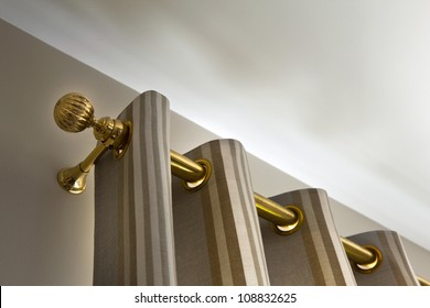Curtains and gilt metal rod
