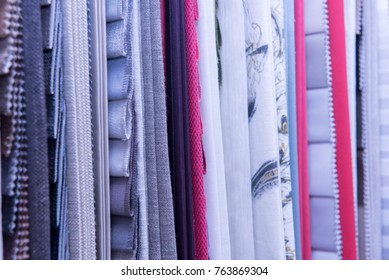 Curtains stacked in a row