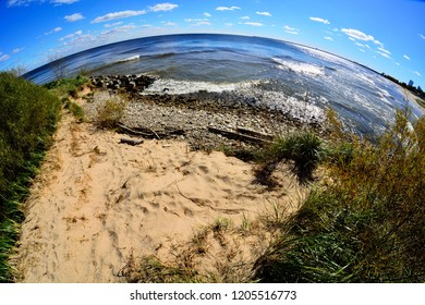 The curvature of the Earth as seen through a fisheye lens with the special effects on the Milwaukee Wisconsin shore of Lake Michigan.