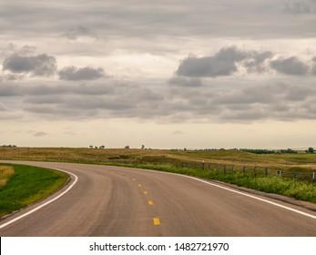 Curve along Outlaw Trail Scenic Byway (Nebraska Highway 12) near Cub Creek Recreation Area, Keya Paha County, in north-central Nebraska, USA, on a cloudy day in summer