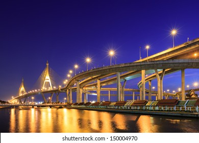 Curve of expressway by river in Bangkok at night
