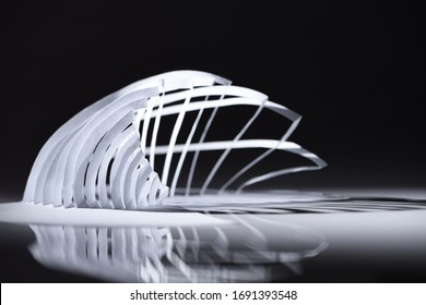 Curve lines seamless architecture pattern made of white folded paper. Geometric minimalist polygonal / polyhedron / geometric design. Close up. Paper architecture. Model / maquette. Paper cuttting.