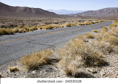 A curve on an empty road in the desert