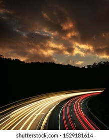 Curve on a street with light trails of the cars passing by