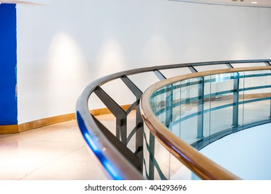 Curve pattern of walkway and railing in the building.