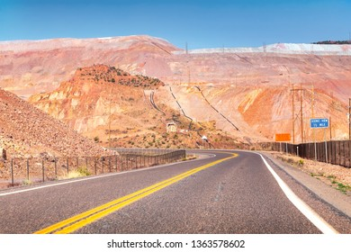 Curve road going through dramatic minefield landscape.