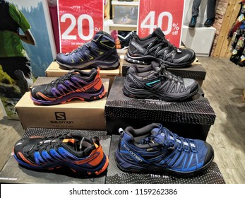 The Curve, Selangor , Malaysia - August 2018 : Salomon shoe brand display for sale at the Salomon store. The Salomon Group is a famous sports equipment manufacturing company.