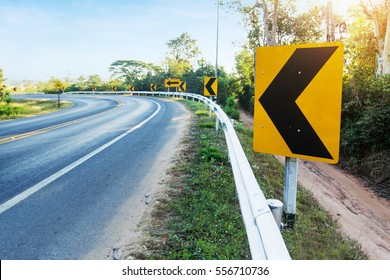 Curve warning sign on the road