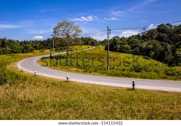 """Curved asphalt road in high mountains at """"khao yai"""" national park thailand"""