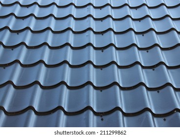 Curved black metal roof with wave design